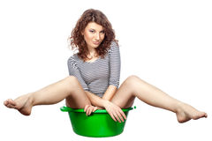 Girl sitting in a basin rides. Stock Photo