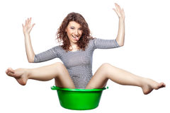 Girl sitting in a basin rides. Royalty Free Stock Photography