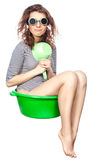 Girl sitting in a basin rides. Royalty Free Stock Photo