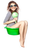 Girl sitting in a basin rides. Royalty Free Stock Images