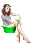 Girl sitting in a basin rides. Royalty Free Stock Photos