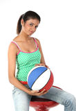 Girl sitting with basket ball Royalty Free Stock Photography