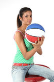 Girl sitting with basket ball Royalty Free Stock Photo