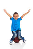 Girl sitting basketball Royalty Free Stock Image