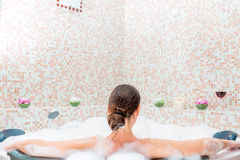 Girl sitting in the bath with foam Stock Photo