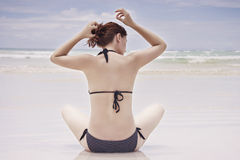 Girl sitting on beach. Royalty Free Stock Image