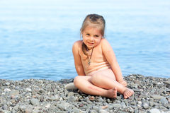 Girl sitting on the beach Royalty Free Stock Image