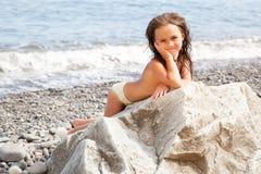 Girl sitting on the beach Royalty Free Stock Photos