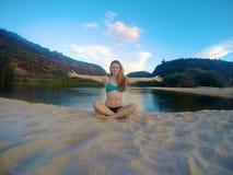 Girl sitting on beach Stock Photos