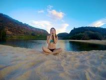 Girl sitting on beach Royalty Free Stock Photo