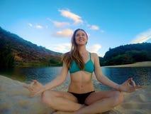 Girl sitting on beach Stock Photography