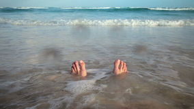Girl Sitting on the Beach and Getting her Feet Wet stock video footage