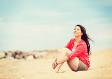 Girl sitting on the beach. Summer holidays and vacation - girl sitting on the beach Stock Photography