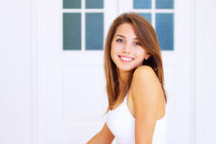 Girl sitting on the bed Royalty Free Stock Photography