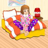 Girl sitting on the bed. Girl in pyjama sitting on the bed Royalty Free Stock Photos