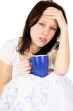 The girl sitting on the bed and a very sore head Royalty Free Stock Images