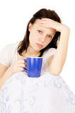 The girl sitting on the bed and a very sore head Stock Image