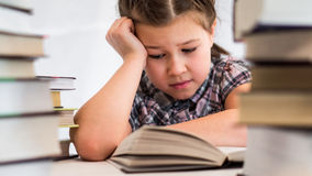 Girl reading books royalty free stock photography