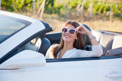 The girl sitting behind the wheel of a white convertible Royalty Free Stock Photo