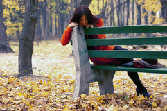 Girl sitting on bench Stock Photography