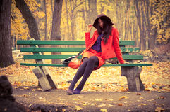 Girl sitting on bench Royalty Free Stock Images
