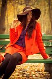 Girl sitting on bench Stock Image