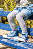 Girl sitting on bench Stock Images