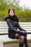 Girl sitting on bench Royalty Free Stock Image
