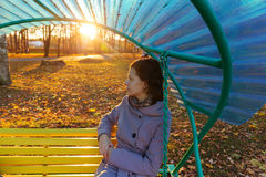 Girl sitting on a bench Stock Photos