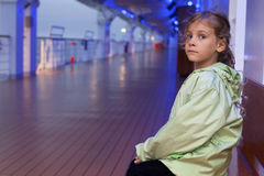 Girl sitting on bench on deck of ship Royalty Free Stock Images