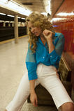 Girl sitting on the bench at empty subway station Stock Images
