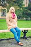 Girl sitting on bench Royalty Free Stock Image