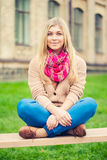 Girl sitting on bench Stock Photos