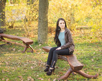 Girl sitting on bench outdoors Royalty Free Stock Images