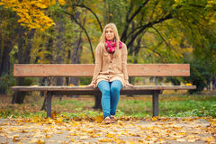 Girl sitting on bench Royalty Free Stock Photo