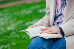 Girl reading on a bench stock photography