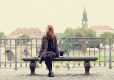 Girl sitting on the bench Royalty Free Stock Photo