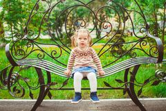 Girl sitting on the bench Royalty Free Stock Images