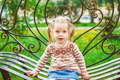 Girl sitting on the bench Stock Photos