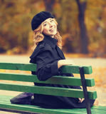Girl sitting at bench Royalty Free Stock Photos
