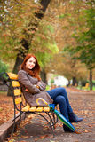 Girl sitting at bench Stock Photography