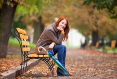 Girl sitting at bench Royalty Free Stock Image
