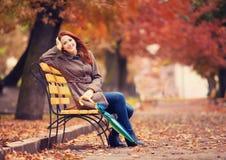 Girl sitting at bench Royalty Free Stock Photos