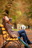 Girl sitting at bench Royalty Free Stock Photo