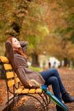 Girl sitting at bench Royalty Free Stock Photo