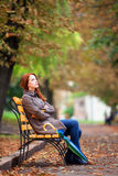 Girl sitting at bench Royalty Free Stock Photography