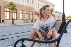 Girl Sitting on a Bench Royalty Free Stock Photos