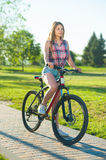 Girl sitting on bicycle Royalty Free Stock Photos