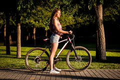 Girl sitting on bicycle Royalty Free Stock Photo