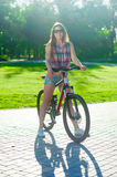 Girl sitting on bicycle Royalty Free Stock Photography